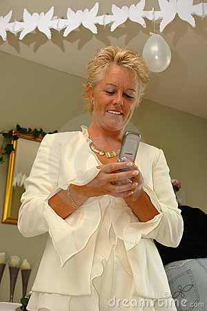Mature lady on a party sending SMS