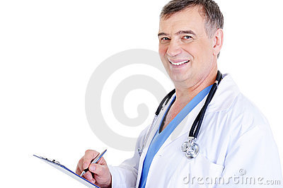Mature male doctor writing something