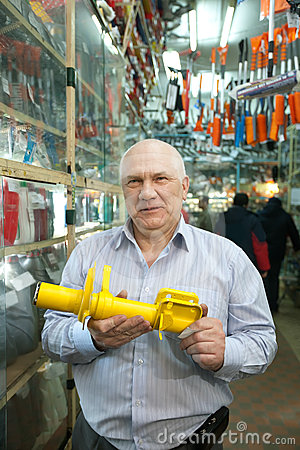 Mature man  in  auto parts store