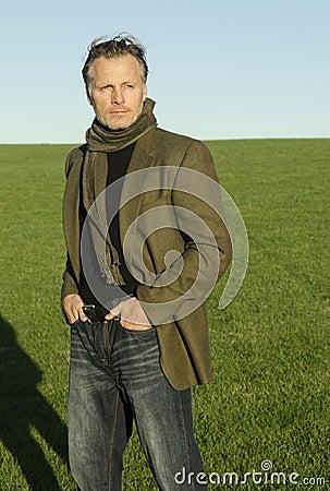 Mature man with beard wearing scarf