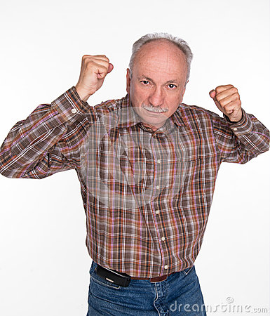 Mature man in boxer pose with raised fists