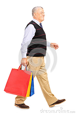 Mature man coming back from shopping