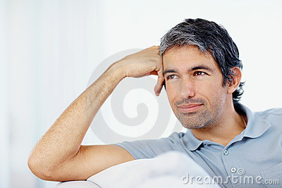 Mature man daydreaming on white background