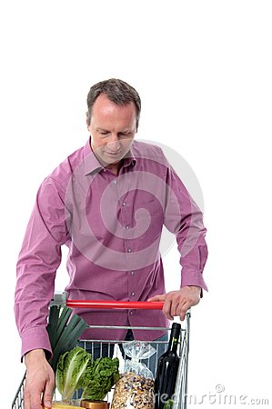 Mature man doing grocery shopping