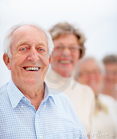 Mature man in front of a group of older people