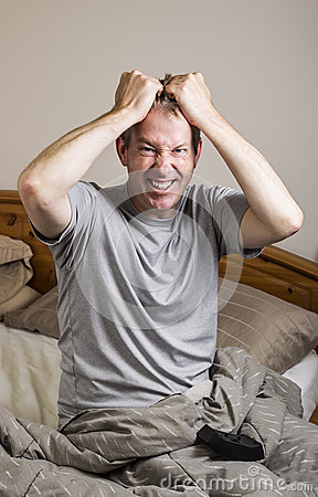 Mature man frustrated at Monday Morning Wake Up