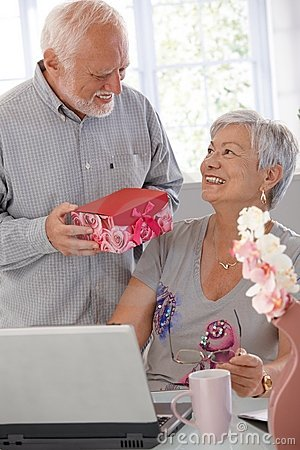 Mature man giving present to wife