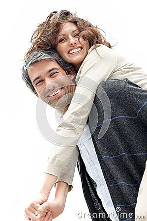 Mature man giving woman piggyback ride