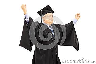 Mature man in graduation gown gesturing success
