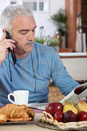 Mature man having breakfast
