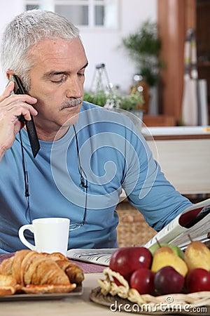 Mature man having breakfast