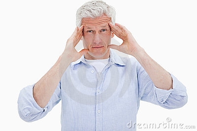 Mature man having a headache