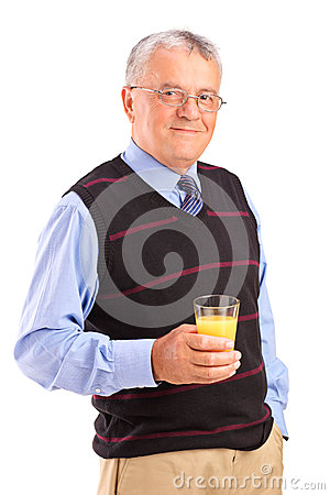 Mature man holding a glass of orange juice