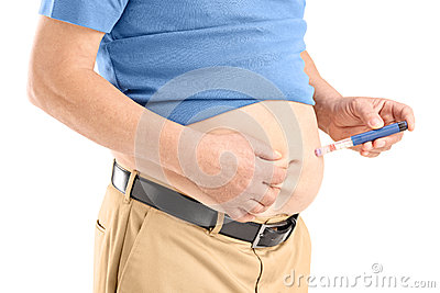 Mature man injecting insulin in his abdomen