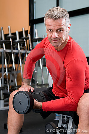 Mature man lifting dumbbells