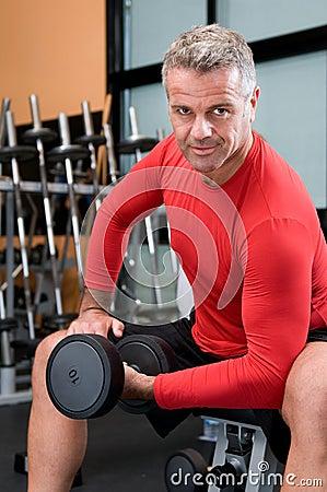Mature man lifting dumbbells