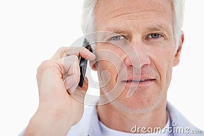 Mature man making a phone call