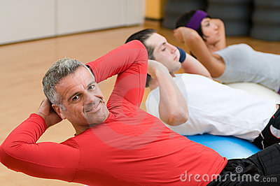 Mature man making sit-ups