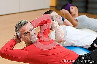 Mature man making sit-ups