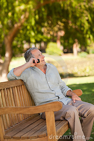 Free Mature Man Phoning In The Park Stock Images - 18465084