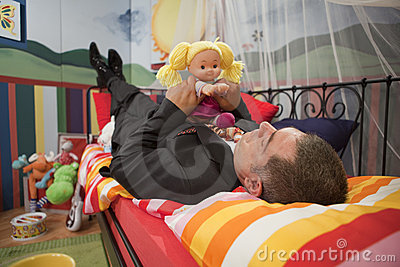 Mature man playing with toys