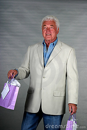 Mature man with presents