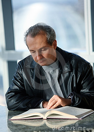 Mature man reading