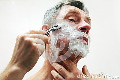 Mature man shaving