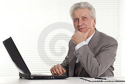 Mature man sitting at the computer