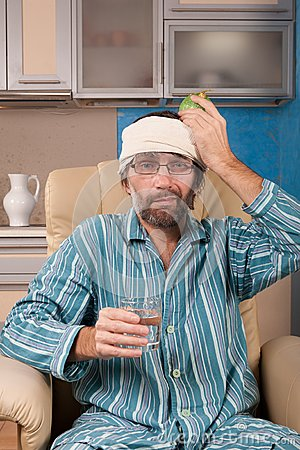 Free Mature Man Sitting In Chair With Glass Of Water Stock Photos - 28522243