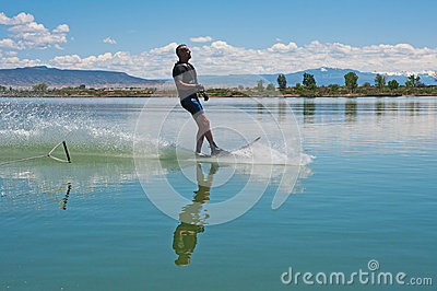 Mature Man Slalom Water Skiing Royalty Free Stock Images