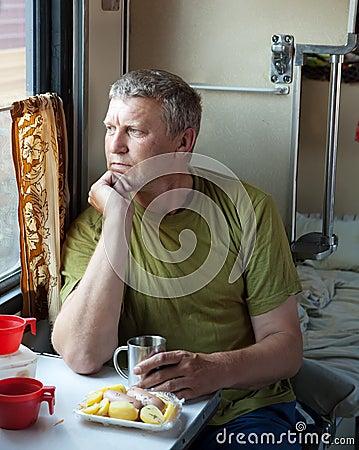 Mature man  in sleeper train