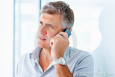 Mature man speaking on a cellphone