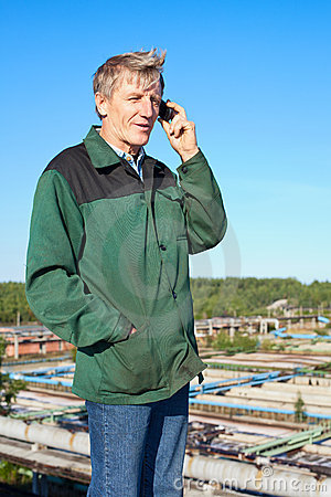 Mature man speaking on phone