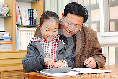 Mature man is teaching girl calculation