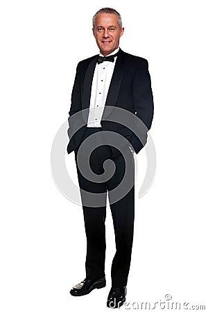 Mature man in tuxedo and black tie.