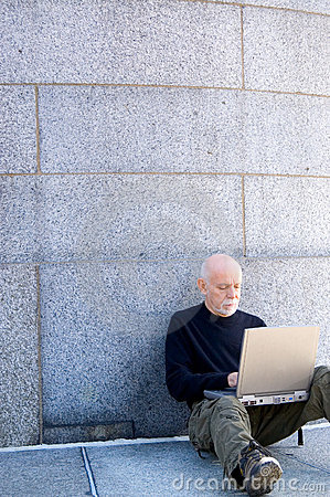 Mature man using a computer