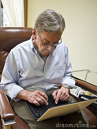 Mature man using a laptop