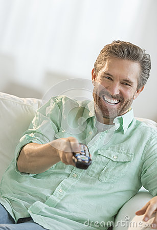 Mature Man Watching TV On Sofa