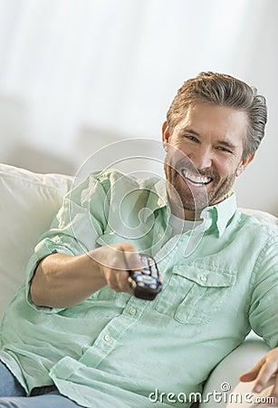 Mature Man Watching TV On Sofa