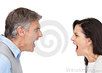 Mature man and woman yelling at each other