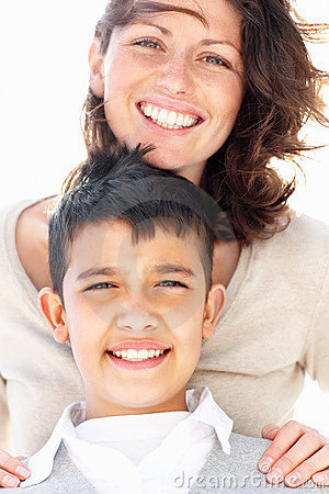 Mature mother and son giving warm smile