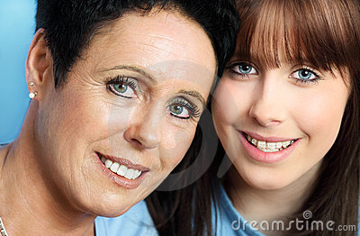 Mature mother and teenage daughter portrait