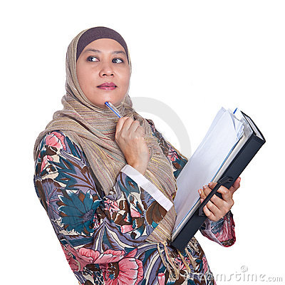 Mature Muslim woman in thinking pose