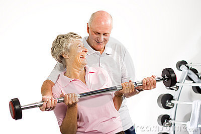 Mature older couple lifting weights