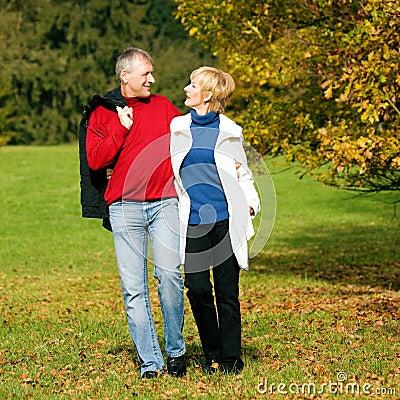 Mature romantic couple in a park