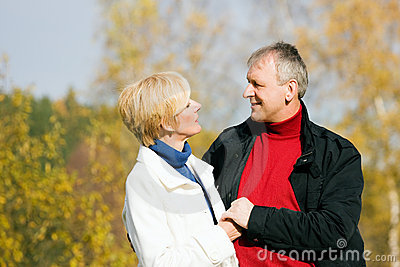 Mature romantic couple in a park