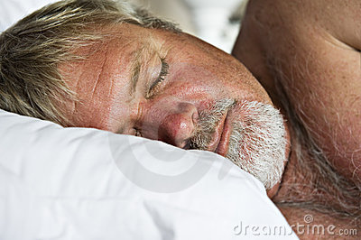 Mature senior man sleeping peacefully