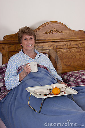 Mature Senior Woman Breakfast in Bed Smiling