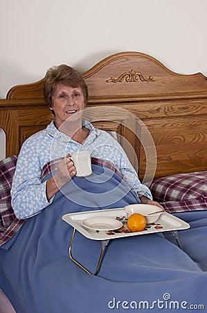 Mature Senior Woman Breakfast in Bed Smiling
